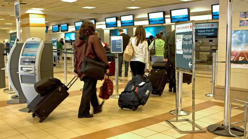 Travellers at Halifax Stanfield International Airport.