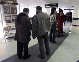 People line up at the Resource Canada offices in Montreal on April 9, 2009. Thousands of Canadians are being told that personal information about them held by the government has gone missing. THE CANADIAN PRESS/Ryan Remiorz