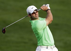 Paul Casey of England plays a ball on the 10th hole during the first round of the Desert Classic Golf tournament in Dubai, United Arab Emirates, Thursday, Jan. 31, 2013. (AP Photo/Kamran Jebreili)