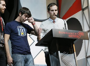 """Director Steve Hoover, right, and documentary subject Rocky Braat, left, accept the Grand Jury Prize: U.S. Documentary for """"Blood Brother"""" during the 2013 Sundance Film Festival Awards Ceremony on Saturday, Jan. 26, 2013 in Park City, Utah. (Photo by Danny Moloshok/Invision/AP)"""