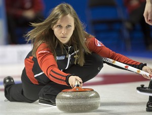 Team Ontario skip Rachel Homan takes a shot during sixth draw curling action against British Columbia at the Scotties Tournament of Hearts Monday, February 18, 2013 in Kingston, Ont.THE CANADIAN PRESS/Ryan Remiorz