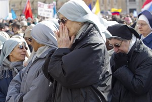 Nuns pray as they wait for Pope Benedict XVI's last Angelus prayer, in St. Peter's Square, at the Vatican, Sunday, Feb. 24, 2013. Benedict XVI gave his pontificate's final Sunday blessing from his studio window to the cheers of tens of thousands of people packing St. Peter's Square, but sought to reassure the faithful that he wasn't abandoning the church by retiring to spend his final years in prayer. The 85-year-old Benedict is stepping down on Thursday evening, the first pope to do so in 600 years, after saying he no longer has the mental or physical strength to vigorously lead the world's 1.2 billion Catholics. (AP Photo/Domenico Stinellis)