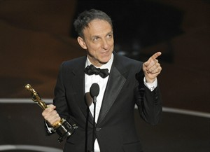 """Mychael Danna accepts the award for best original score for """"Life of Pi"""" during the Oscars at the Dolby Theatre on Sunday Feb. 24, 2013, in Los Angeles. (Photo by Chris Pizzello/Invision/AP)"""