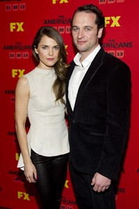 "FILE - This Jan. 26, 2013 photo shows Keri Russell left, and Matthew Rhys at the premiere of the FX television series ""The Americans"" in New York. The new FX drama, airing Wednesday at 10 p.m. EST on FX, focuses on two KGB spies posing as an ordinary American couple shortly after Ronald Reagan was elected president. (Photo by Charles Sykes/Invision/AP, file)"