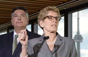 Ontario Premier Kathleen Wynne and Finance Minister Charles Sousa hold a media availability in Toronto, Monday, March 17, 2014. THE CANADIAN PRESS/Frank Gunn